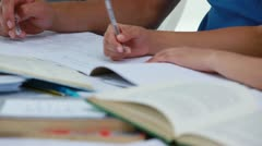 Students seriously doing their homework Stock Footage