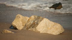 Waves Wash Shore Sands and Rock Stock Footage