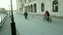 People cycling in Gamla Stan Stock Footage