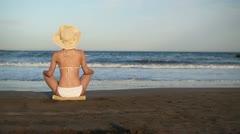 Sexy woman in bikini relaxing on the beach, slow motion HD Stock Footage