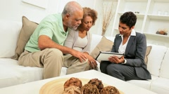 Female Financial Expert Home Meeting Retired Couple - stock footage