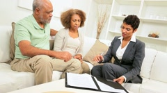 Older Ethnic Couple Meeting Financial Advisor Home Stock Footage