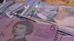 Dolly shot over currencies of the world Stock Footage