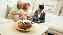 Senior Ethnic Couple Meeting Saleswoman Home Stock Footage