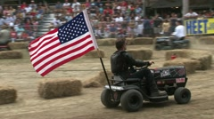 Lawnmover race with man with flag Stock Footage
