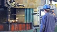 Worker grinding wheel of locomotives - stock footage