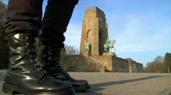 10674 nazi boots jump emperor monument Stock Footage