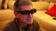 Expression Of Man Watching And Commenting A 3D Movie Stock Footage
