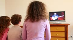 Mother with kids boy and little girl sit watch tv Stock Footage