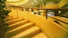 Winding staircase in multiple floor hotel Stock Footage
