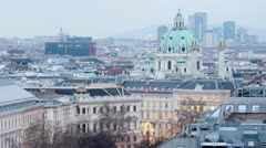 Domes of Karlskirche Church extend upward above city landscape Stock Footage