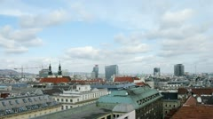 Roofs of houses and Church of Jesuits against city landscape in Vienna Stock Footage