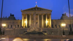 Tourists walk near Austrian parliament in evening Stock Footage