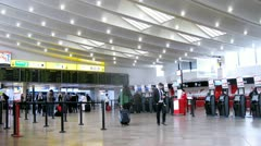 Passengers wait for flight in  terminal room on Shvehat aeroport Stock Footage