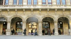 Tourists walk in front of building of Viennese opera Stock Footage