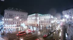 Cars go on crossroads near Viennese State opera when go rain Stock Footage