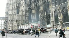 Tourists walk and are photographed in front of Stephansdom Stock Footage