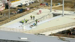 Workers lay an insulating cover on roof Stock Footage