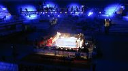Stock Video Footage of Boxers battle on ring, on World series of boxing among club commands