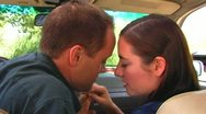 Stock Video Footage of Young Couple Automobile Make-Out Session