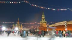 Adults and children skate on main skating rink of country near Kremlin Stock Footage