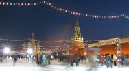 Stock Video Footage of Adults and children skate on main skating rink of country near Kremlin