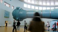 Stock Video Footage of Group of tourists examines centrifuge in building hydrolaboratory of Star town