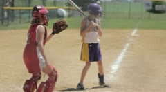 Stock Footage - Girls Softball - Batter, Umpire, Catcher at Mound Stock Footage