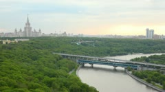 Luzhnetsky bridge stands against the Moscow State university Stock Footage