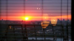 Sunset and flow of cars is visible from window Stock Footage