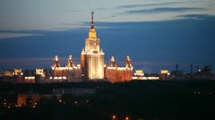Building of Moscow State university stands against night sky Stock Footage