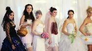 Models are in wedding dresses on exhibition WORLD OF WEDDINGS 2011 Stock Footage
