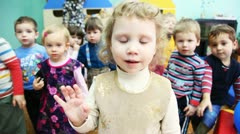 Nice girl and other kids carefully look into camera in a Moscow kindergarten 143 Stock Footage