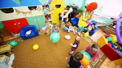 Big red clown girl plays with children in Moscow kindergarten 143 Stock Footage