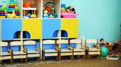 Kindergarten room with colorful toys on shelves, panorama Stock Footage