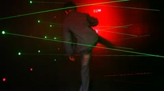 Boy passes obstacles in form of laser beams on amusement ride and leaves Stock Footage