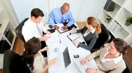 Business Executives Finance Meeting - Overhead View Stock Footage