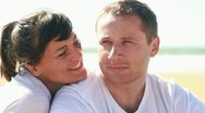 Portrait of young happy couple on the beach Stock Footage