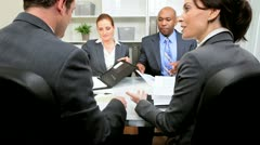 Ethnic and Caucasian Business Team Meeting - stock footage