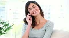 Woman laughing while having a conversation on her mobile phone Stock Footage