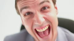 Close-up of a happy man grinning - stock footage