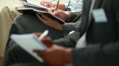 Business people writing on notepads Stock Footage