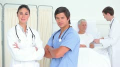 Doctors standing while crossing their arms Stock Footage