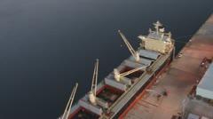 Aerial Cargo Ship Unload Dusk 2 Stock Footage