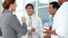 Colleagues talking at coffee break Stock Footage