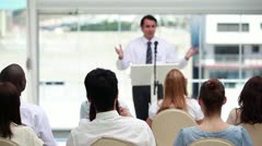 Man in suit speaking in a meeting Stock Footage