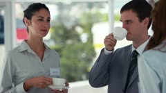 People in suits taking during a coffee break Stock Footage
