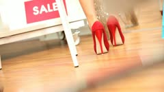 Fashionable Females Admiring New Shoes Stock Footage