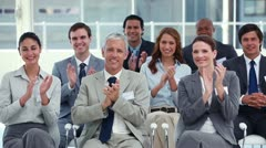Business people applauding during a meeting - stock footage