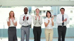 Smiling business people applauding - stock footage